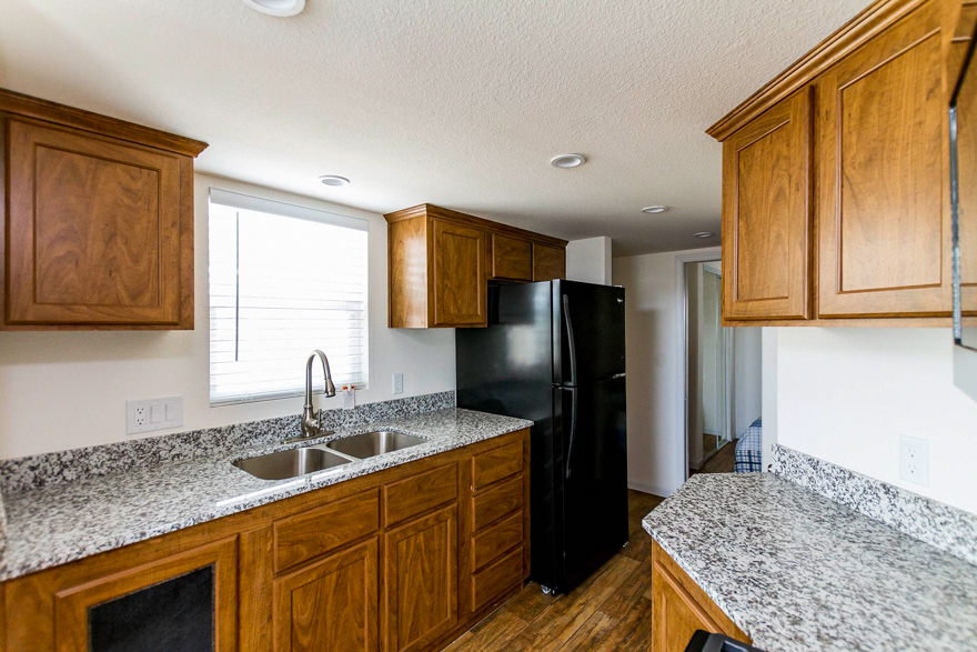 Morgan Hill Interior Showing- Tape and Textured Walls in Egret, Granite Counter Tops, Linoleum Flooring in Antique Bronze Throughout, Cabinets in Mountain Alder Throughout, 2
